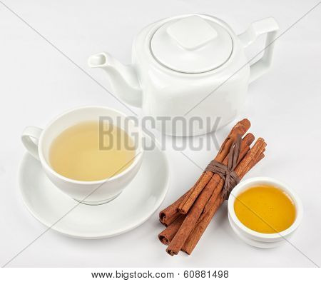 Cup of hot linden tea with cinnamon sticks, and honey