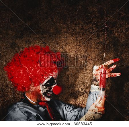 Evil Halloween Clown With Big Scary Needle