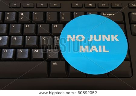 No junk mail, sticker on black computer keyboard
