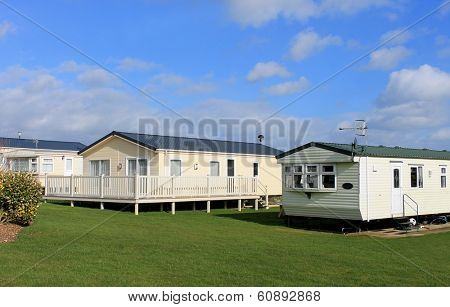 Scenic view of modern trailer of caravan park in summer.