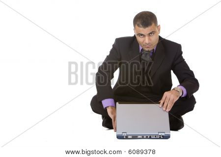 Business Man Starts To Work On Laptop
