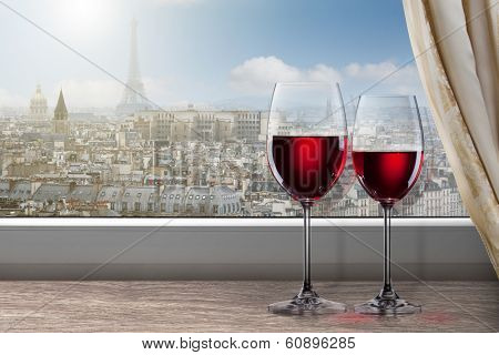View of Paris and Eiffel tower from window with two glasses of wine