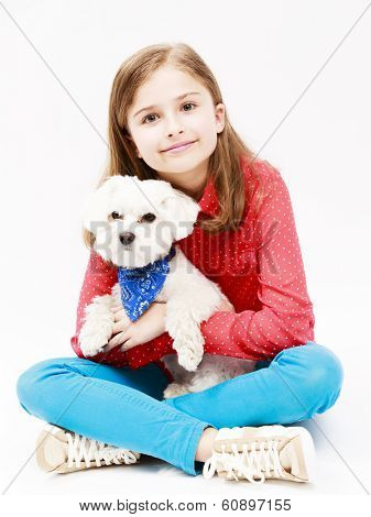 Young girl with  puppy, cute Maltese dog  - best friends