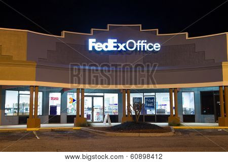 JACKSONVILLE, FL - FEBRUARY 25, 2014: A FedEx Office retail store at night. FedEx Office is a chain of stores that provide a retail outlet for FedEx Express and FedEx Ground shipping.
