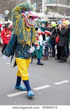 Person Wearing Carnival Costume And Walking In Carnival Parade