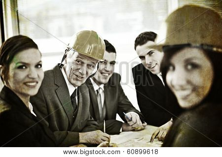 Group of bussiness people and architects having meeting at office