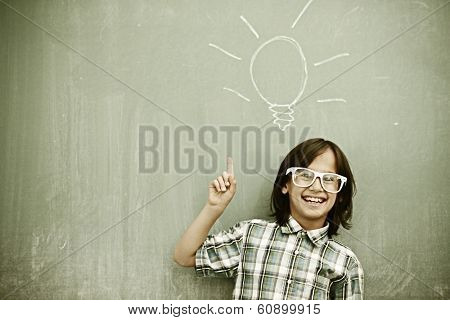 Cheerful kids at school room having education activity on chalkboard