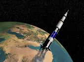 stock photo of saturn  - Saturn V spaceship flying upon the earth  - JPG
