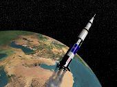 foto of saturn  - Saturn V spaceship flying upon the earth  - JPG