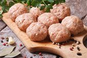 image of meatballs  - raw meatballs on a chopping board and ingredients - JPG