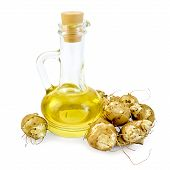 stock photo of jerusalem artichokes  - Jerusalem artichoke carafe with vegetable oil isolated on white background - JPG