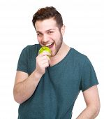 Handsome Young Man Eating Green Apple