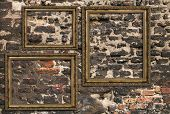 picture of triptych  - Three wooden frames over ruined brick wall - JPG