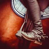 image of saddle-horse  - vintage stylized photo of jockey riding boot horses saddle and stirrup - JPG