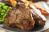 stock photo of lamb chops  - Homemade Cooked Lamb Chops with Peas and Carrots