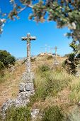 image of judas  - isolated stone crosses located on a hill - JPG