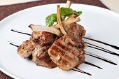 stock photo of lamb chops  - Roasted Lamb Chops on Tomato Sauce - JPG