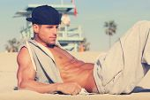 picture of hunk  - Hot young guy at the beach with very subtle retro toning - JPG