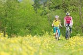 Bike riding - young girl with mother on bike, active family concept