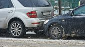 foto of slippery-roads  - car crash collision accident on an city road in winter - JPG