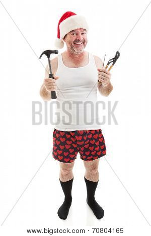 Father ready with tools to assemble Christmas presents for the kids.  Full body isolated on white.