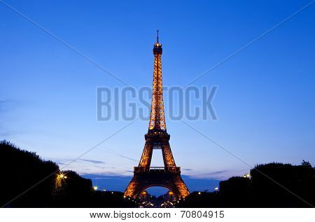 The Eiffel Tower In Paris At Dusk