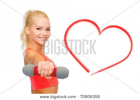 fitness, sport and diet concept - smiling beautiful sporty woman, focus on dumbbell