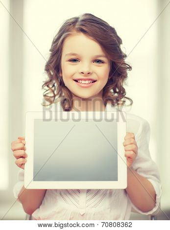 picture of beautiful pre-teen girl with tablet pc