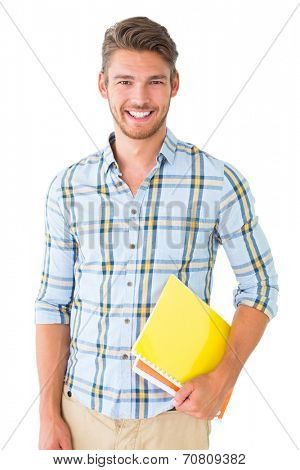 Handsome student holding notepad smiling at camera on white background