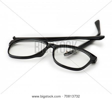 Broken eye glasses, isolated on white. Black plastic frame