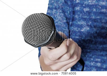 a woman is holding a microphone in hand. interview and opinion poll