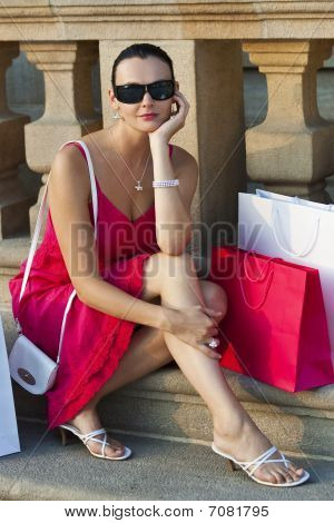 Beautiful Latina Hispanic Woman Sitting With Shopping Bags
