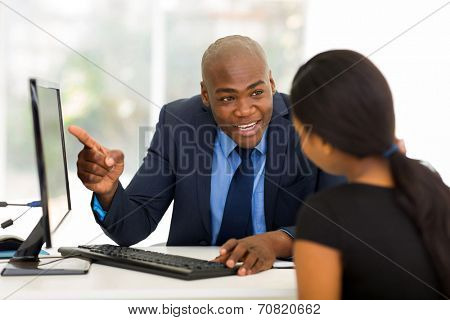 happy african businessman meeting with client in office