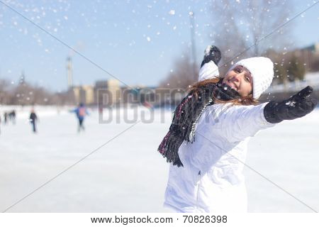 Happy Woman Playing With The Snow During Winter