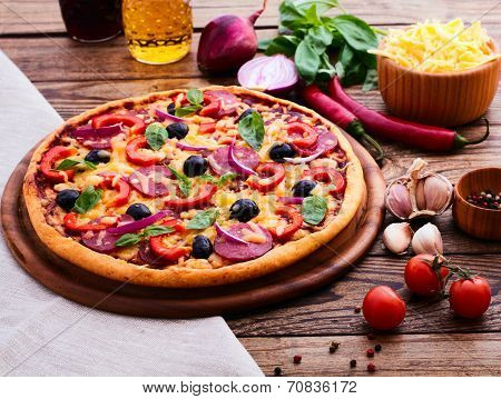 Pizza With Ham, Pepper And Olives. Delicious Fresh Pizza Served On Wooden Table.