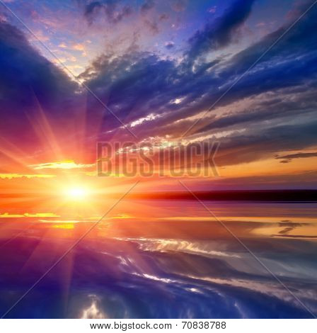 Nice landscape with sunset on lake over water surface