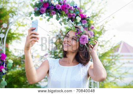 Bridesmaid Photographed In Front Of The Arch For The Wedding Ceremony. Floristic Composition In Vint