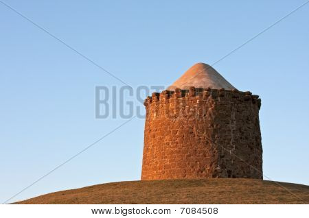 Stone Monument On A Hilltop