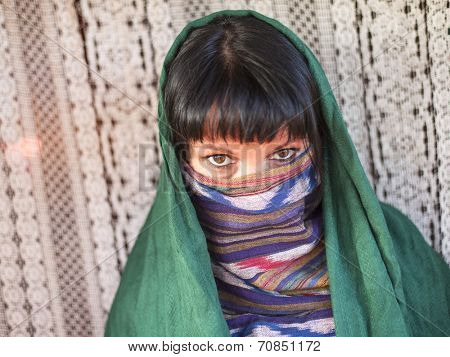 Hijab. Portrait of young girl covers her face with a veil.