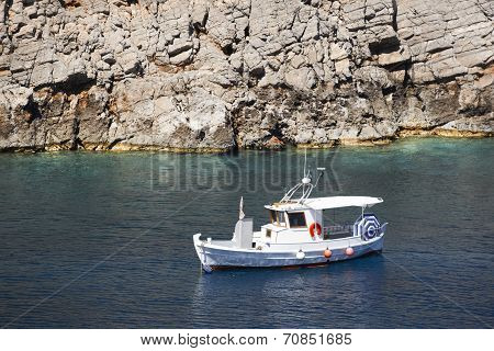 Boat In Sostis Bay. Cretan Beach. Mediterranean Sea. Greece