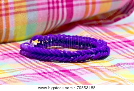 Close Up Of  Purple Colour Bracelets Made With Rubber Bands
