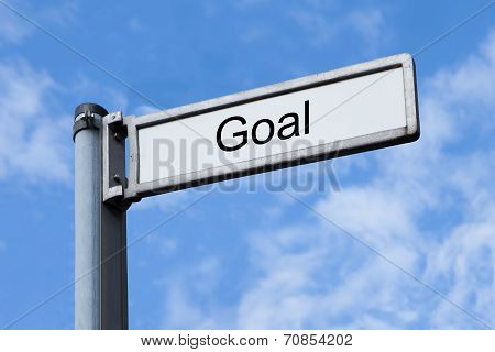 Signpost With Goal Sign Against Sky