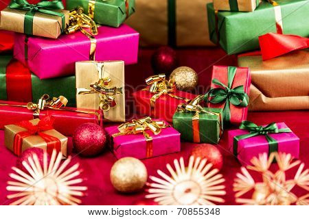 Numerous Xmas Gifts Arranged On A Red Cloth