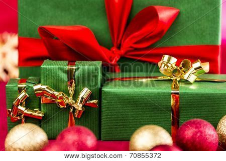 Four Xmas Presents With Bows In Gold And Red