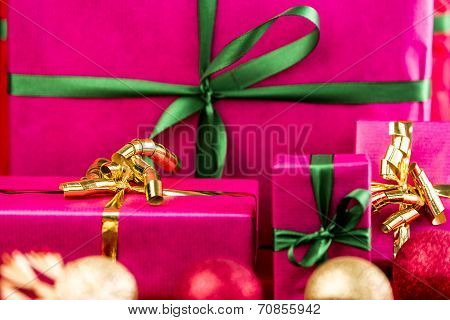 Four Xmas Presents Wrapped In Plain Magenta