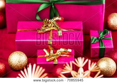 Four Plain Christmas Presents In Magenta