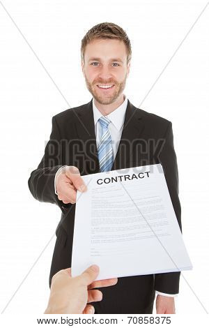 Happy Businessman Giving Contract Paper Over White Background