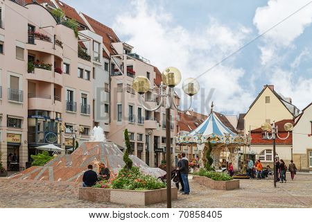 Colmar, France - 18 August, 2014: Modern town street. Colmar is the most popular tourist destination in France, founded in the 9th century.