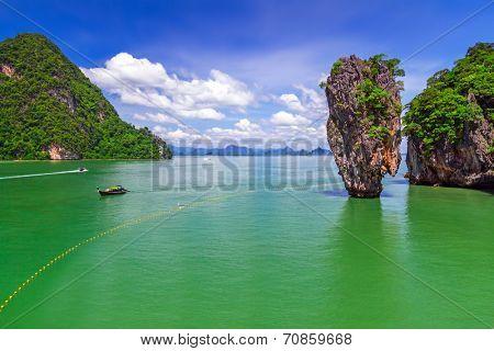 PHANG NGA BAY, THAILAND - 8 NOV 2012: Ko Tapu rock in Phang Nga National Park, Thailand. This place known as the James Bond Island is biggest tourist attraction on Phang Nga Bay.