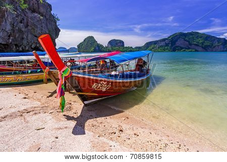 PHANG NGA BAY, THAILAND - 8 NOV 2012: Long tail boats on the coast of James Bond Island. This is the biggest tourist attraction in Phang Nga National Park, Thailand.